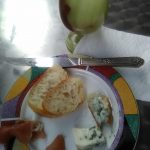 Roquefort cheese, San Daniel Prociutto and white wine in alabaster glass
